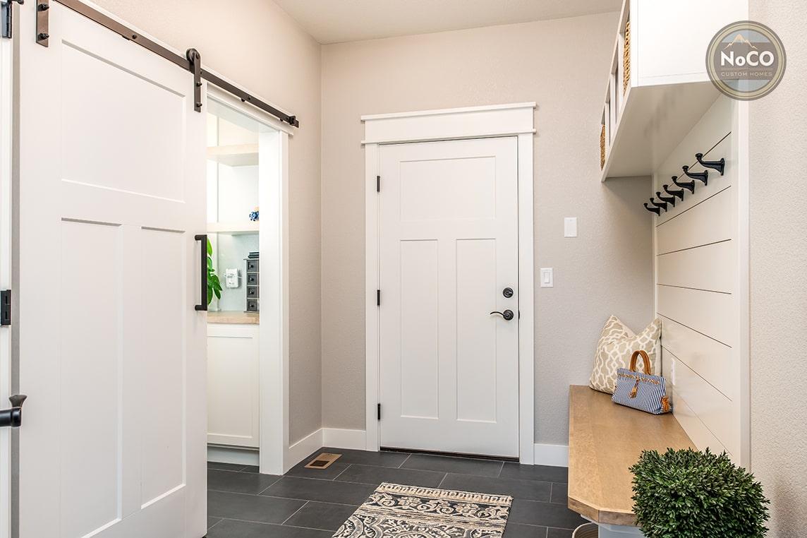 colorado custom home mudroom sliding barn door