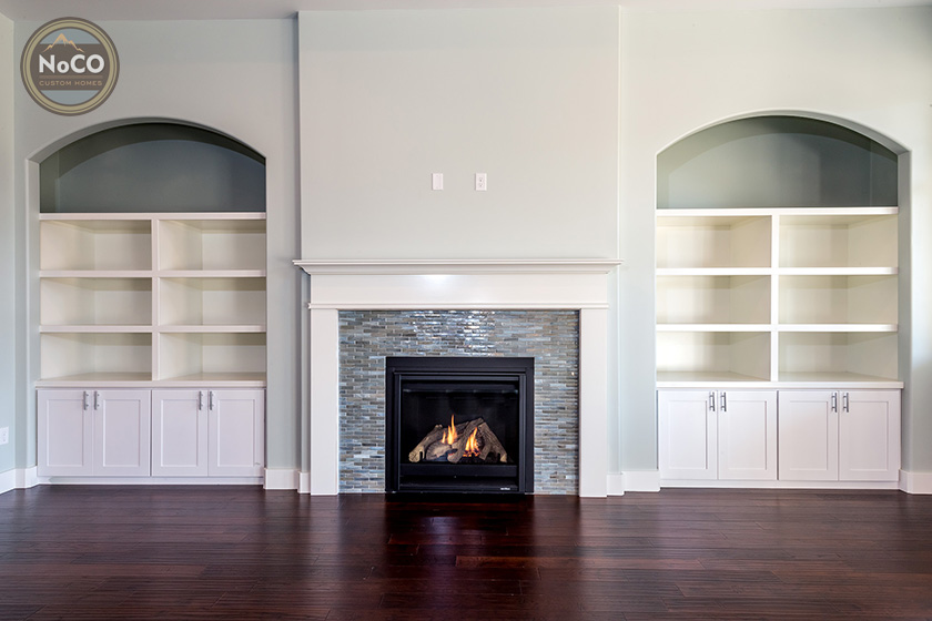 colorado custom home fireplace built in cabinets