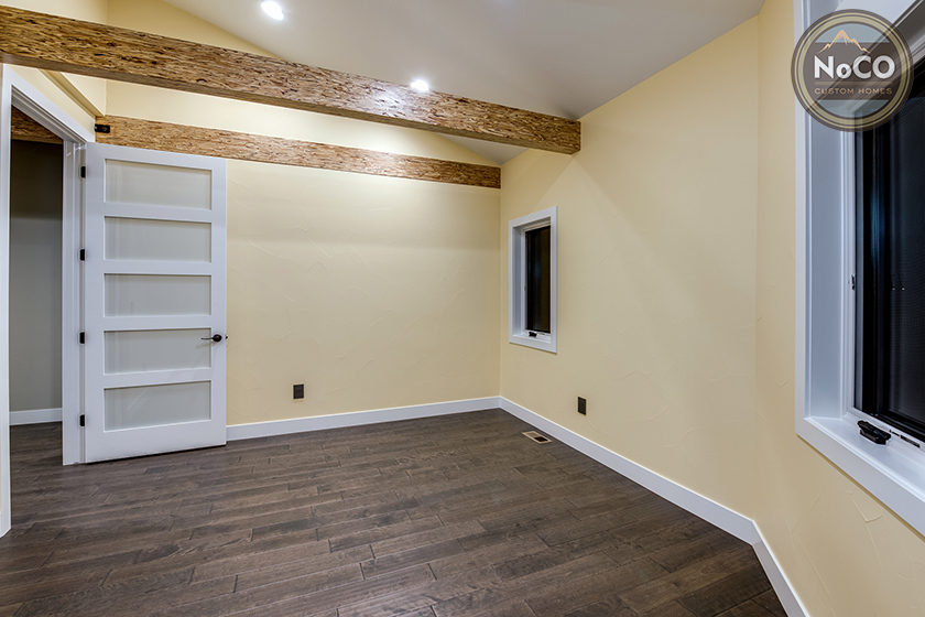 colorado custom home bedroom wood beams