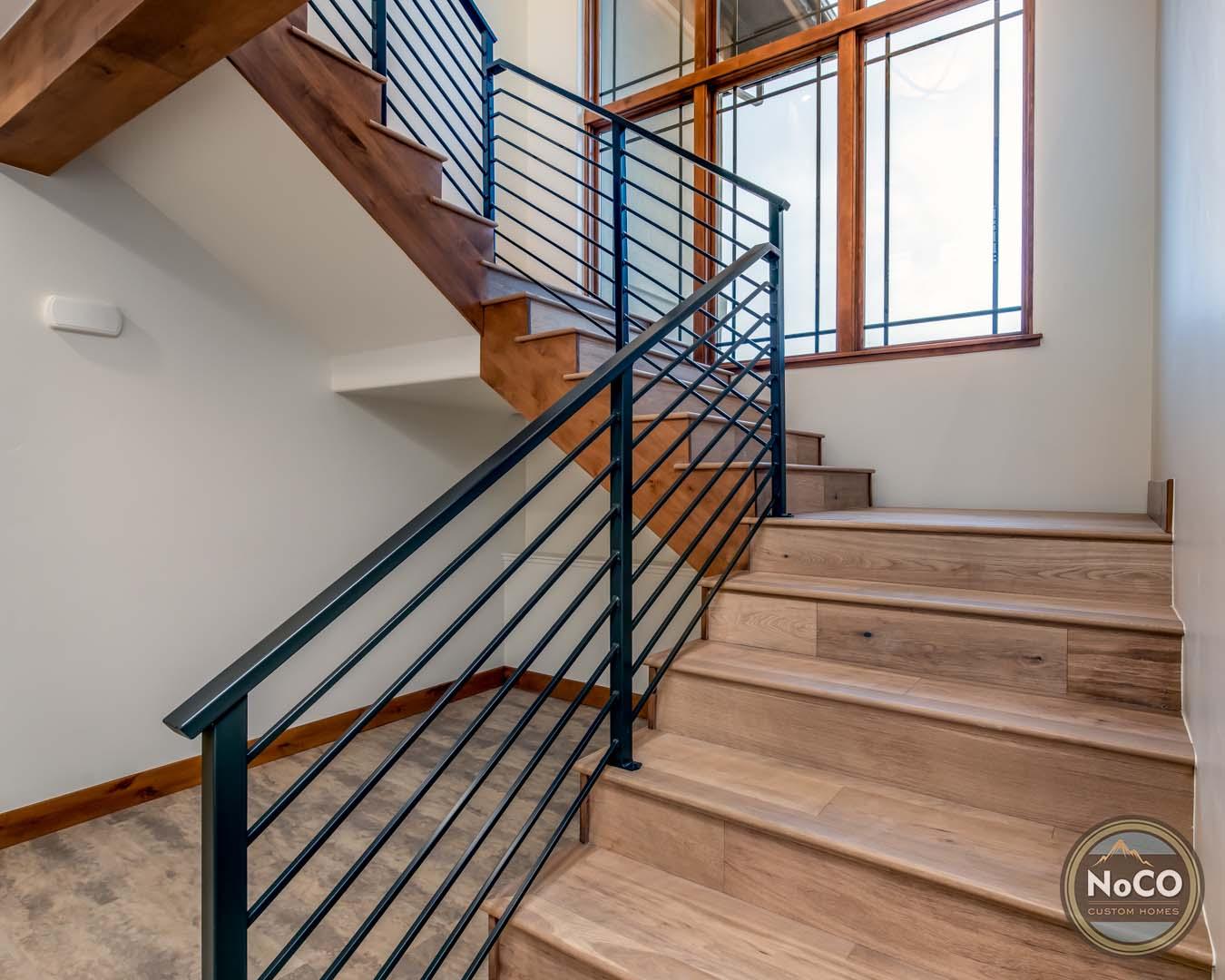 colorado custom home metal railing staircase